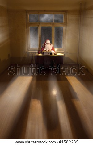 Santa Claus in a big room sitting by the desk