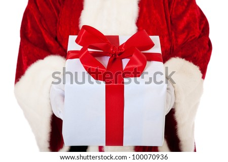Santa Claus in authentic look hands over fine wrapped present. All on white background.