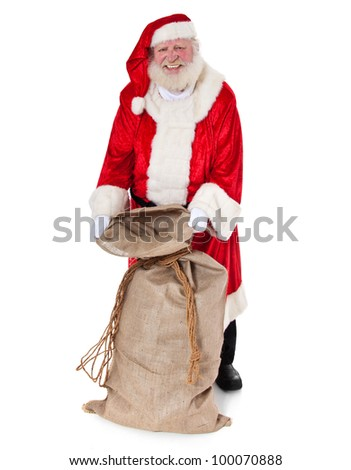 Santa Claus in authentic look opening his bag of presents. All on white background.