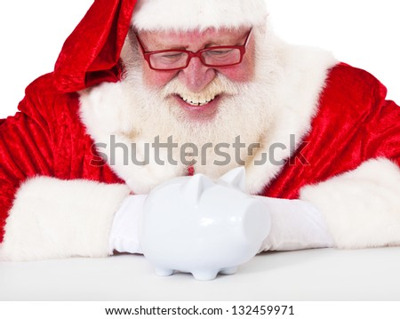 Santa Claus in authentic look with piggy bank. All on white background.