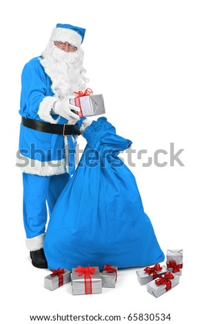Santa claus in blue costume gives a present on white background