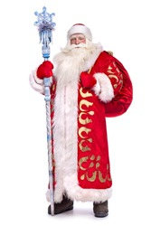 Santa Claus in full growth with a staff and a bag