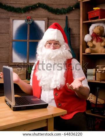Santa Claus in his workshop with laptop and surrounded by toys and presents. Santa is gesturing with both hands with surprised expression.