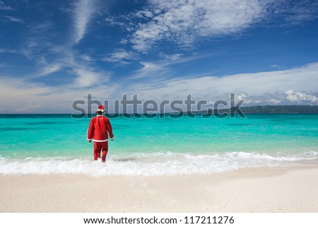 Santa Claus is going in to Ocean - stock photo