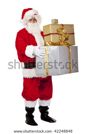 Santa Claus is holding several Christmas gifts in his hands. Isolated on white.