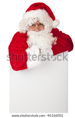 Santa Claus is leaning on a white board with space for Christmas offers. Isolated on white.