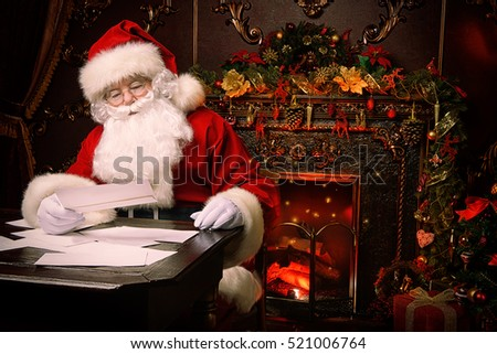 Santa Claus is preparing for Christmas, he is reading children\'s letters. Mail of Santa Claus. Christmas decoration.