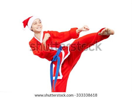 Santa Claus makes the techniques of karate - Shutterstock ID 333338618