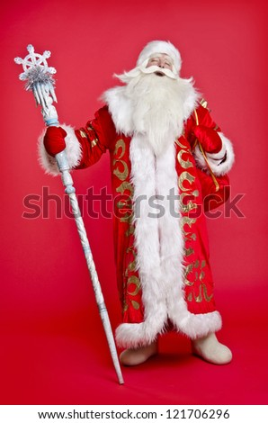 Santa Claus on a red background with a bag