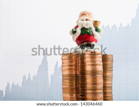 Santa Claus on a stack of coins with financial report background