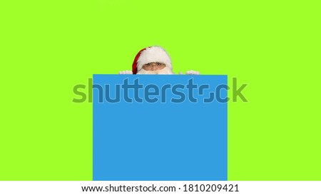 Photo of  Santa Claus on green screen background and blue screen for your own text or animations, Chroma key