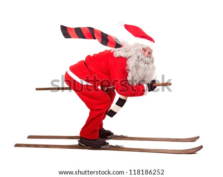 Santa Claus on retro skis isolated on white background. Santa Claus skiing sports. Rushing Santa Claus flies on old wooden skis with flowing scarf. Funny Santa Claus hurry jumping on white background.