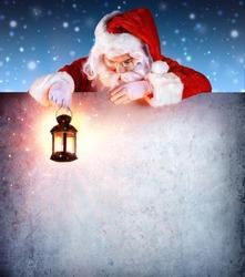 Santa Claus On Vintage Billboard With Lantern