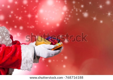 santa claus or papa noel with hands full of christmas gifts Foto stock ©