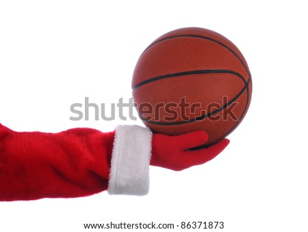 Santa Claus outstretched arm holding a Basketball. Horizontal format over a white background.