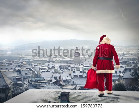 Stock Photo Santa Claus over the city with red sack