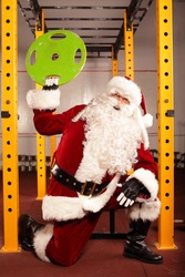Santa Claus physical condition training before Christams time in gym