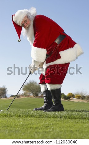 Santa Claus playing golf in leisure time