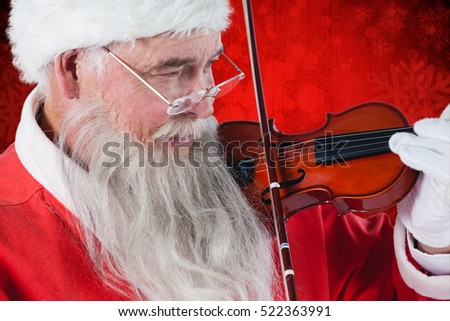 Santa Claus playing violin against red paint splatter background #522363991