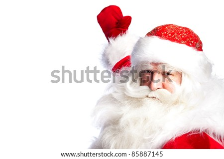 Santa Claus pointing his hand isolated over white.
