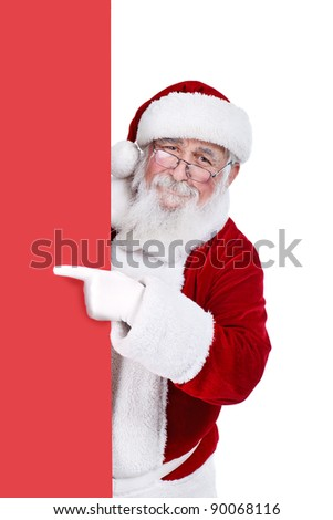 Santa Claus pointing in blank red banner, isolated on white background