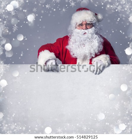 Santa Claus pointing in blank sign #514829125