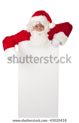 Santa Claus points on Christmas advertisment offer. Isolated on white. - stock photo