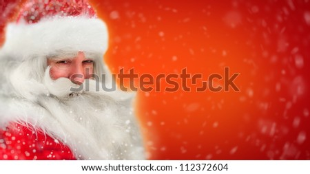 Santa Claus portrait smiling in snowfall