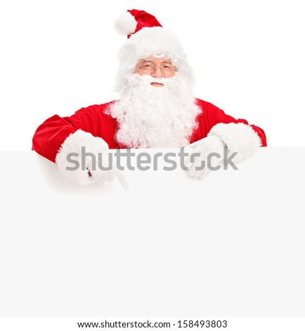 Santa claus posing behind a blank billboard and pointing isolated on white background, shot with a tilt and shift lens