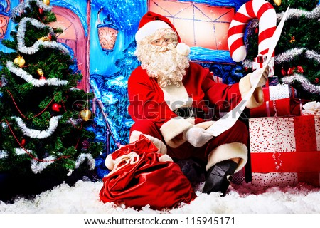 Santa Claus posing with a list of presents over Christmas background