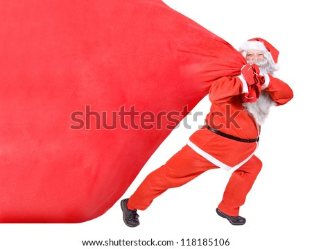 Santa Claus pull the big heavy bag full of Christmas gifts. Santa carries a large red sack isolated on a white background.  - Shutterstock ID 118185106