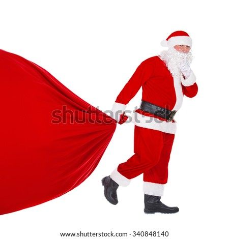 Santa Claus pull the huge Christmas bag full of gifts, presents, and surprises isolated on white background, New Year's or xmas concept - Shutterstock ID 340848140