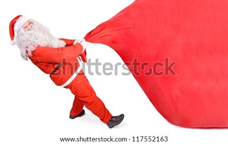 santa claus pulling a big bag