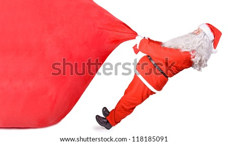 Santa Claus pulling a big bag isolated on white background. Giant Christmas surprise.