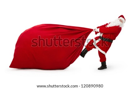Santa Claus pulling huge bag full of christmas presents isolated on white background #120890980