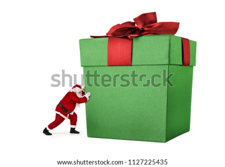 Santa Claus pushing huge gift box full of presents isolated on white background - Shutterstock ID 1127225435