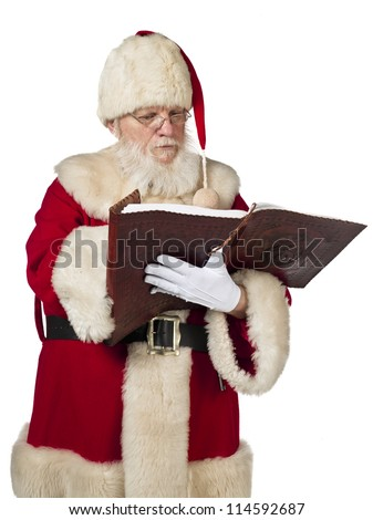 Santa Claus reading a book on white background