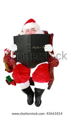 "Santa Claus reads from his book of Who has been ""Naughty or Nice"" isolated on white with room for your text. Shot with a Fisheye lens for a fun festive image."