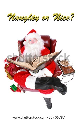 """Santa Claus reads from his book of Who has been """"Naughty or Nice"""" isolated on white with room for your text. Shot with a Fisheye lens for a fun festive image."""