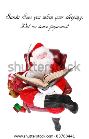 """Santa Claus reads from his book of Who has been """"Naughty or Nice"""" isolated on whtie with room for your text. Shot with a Fisheye lens for a fun festive image."""