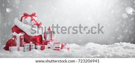 Santa Claus red bag with gift boxes.  #723206941