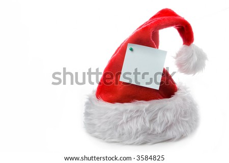 santa claus red cap with note on white - stock photo