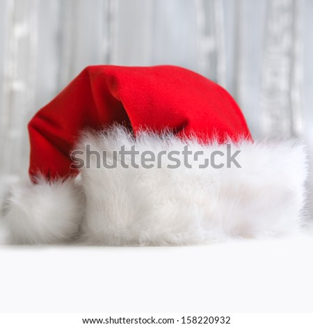 Santa Claus red hat on light background