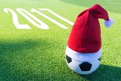 Santa Claus red hat on soccer ball with text new year 2017