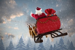 Santa Claus riding on sled with gift box against snow falling on fir tree forest