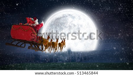 Stock Photo Santa Claus riding on sleigh with gift box against bright moon over city