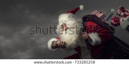 Santa Claus running and delivering Christmas presents: he is late and losing gifts from his sack