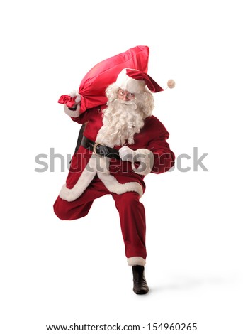 Santa Claus runs with big red sack