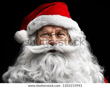 Santa claus's human face on  black background #1203153943