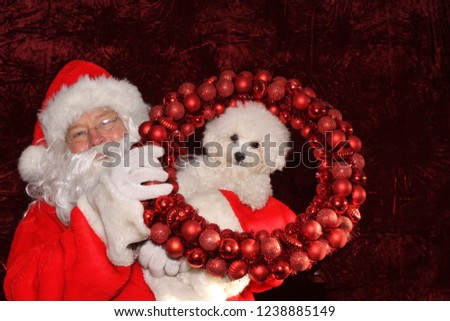 Santa Claus. Santa Claus. Santa Claus poses with a Dog for a Christmas Photo Shoot. Gold Sequin background. Christmas holiday images. Dogs love Santa.  #1238885149